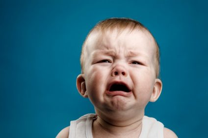 Photo of nine month baby crying, isolated