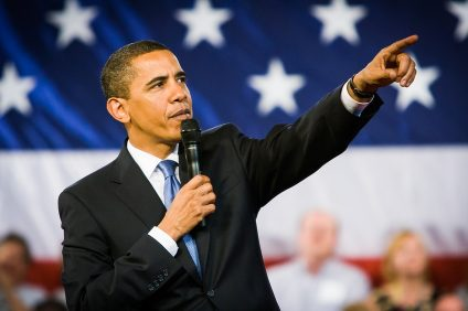 President Obama takes questions from the audience during a town hall forum in Arnold, MO on to commemorate his 100th day in office. (Apr. 29, 2009)