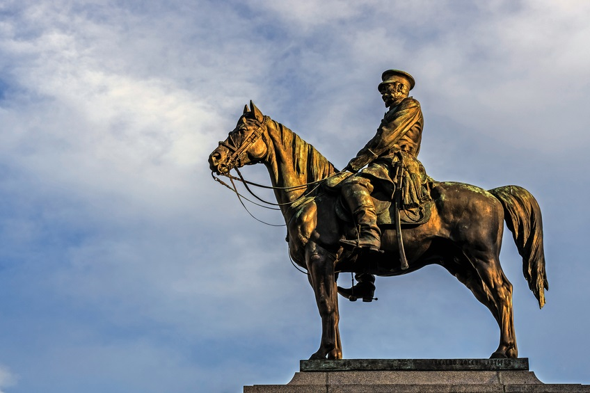 """SOFIA, BULGARIA - FEBRUARY 14, 2016: Monument to Russian Tsar Alexander II, called locally """"the liberator. Monument faces the National Assembly of Bulgaria with the Radisson Blu hotel behind."""