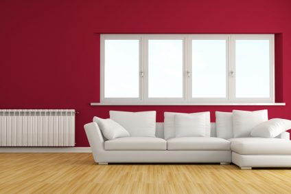 modern living room with white sofa and hot water radiator