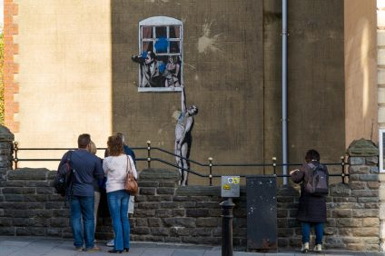 Viewed from Park Street, Naked Man - is an original example of Banksy grafitti artwork in Bristol which itself has been defaced by a paint bomb attack