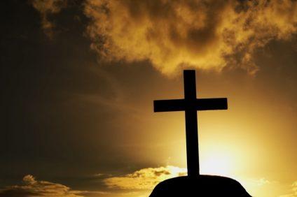 cross at grave when sunset light