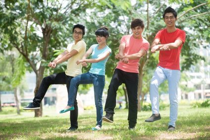 Image of friends doing a gangnam style dance