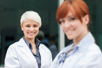 photo of two female doctors smiling towards the camera