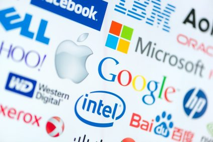 KIEV, UKRAINE - JUNE 12, 2014: A logotype collection of well-known world top companies of computer technologies on a monitor screen. Include Google, Apple, Microsoft, Intel and other logo.